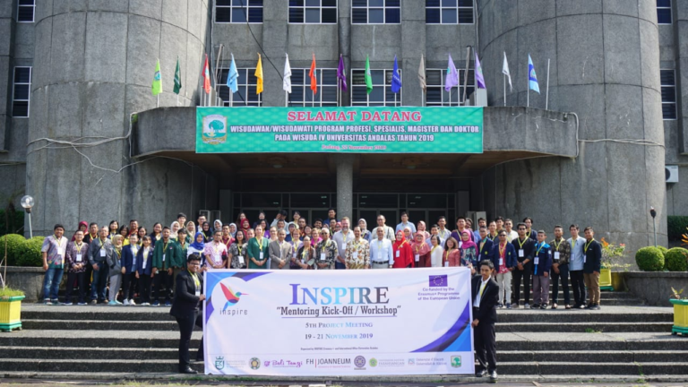 Participants of the INSPIRE Mentoring Kick-Off / Workshop and 5th Project Meeting Taking a picture in front of the Andalas University Auditorium.